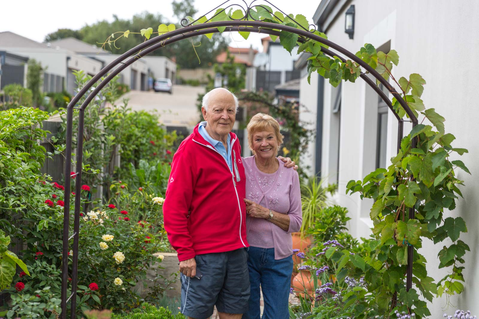 Retired couple standing outside their life rights home