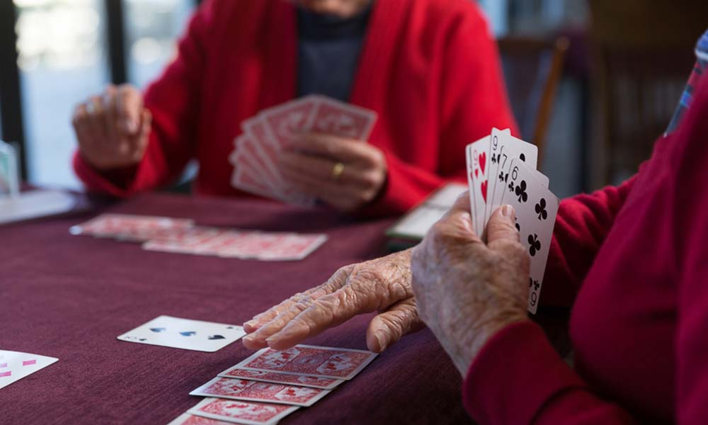 Retired people playing card games to help improve their memory