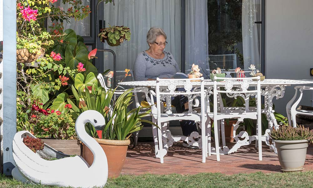Retired Life Right holder sitting on their patio