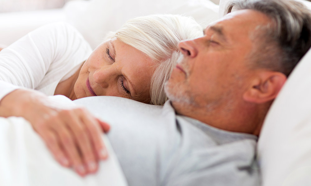 Retired couple sleeping
