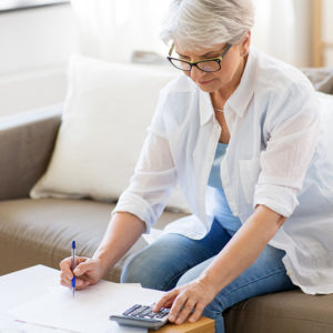 Retired person budgeting their pension